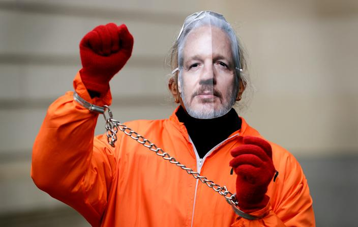 A demonstrator supporting Julian Assange wears a mask and chains outside Westminster Magistrates Court in London, on Jan. 23, 2020.