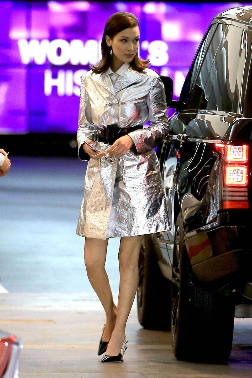 <p>In a metallic belted coat and patent leather slingback heels by Dior while out in LA.</p>