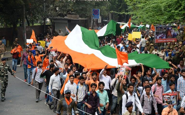 <p>Indian students of Akhil Bharatiya Vidyarthi Parishad (ABVP), the student wing of the country's ruling Bharatiya Janata Party (BJP), shout slogans as they carry India's national flag during a protest march saying they will not tolerate those who talk about breaking the country, on the Delhi University campus in New Delhi on March 2, 2017. / AFP PHOTO / Sajjad HUSSAIN </p>