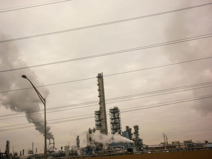 Smoke pours out of towers of the Phillips 66 Bayway oil refinery along the New Jersey Turnpike in Linden, New Jersey. The refinery is one of the largest air polluters in the state.