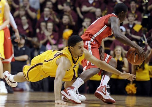 Minnesota's Julian Welch (0) dives as Ohio State's Shannon Scott (3) changes direction in the second half during an NCAA college basketball game in Minneapolis on Tuesday, Feb. 14, 2012. (AP Photo/Hannah Foslien)