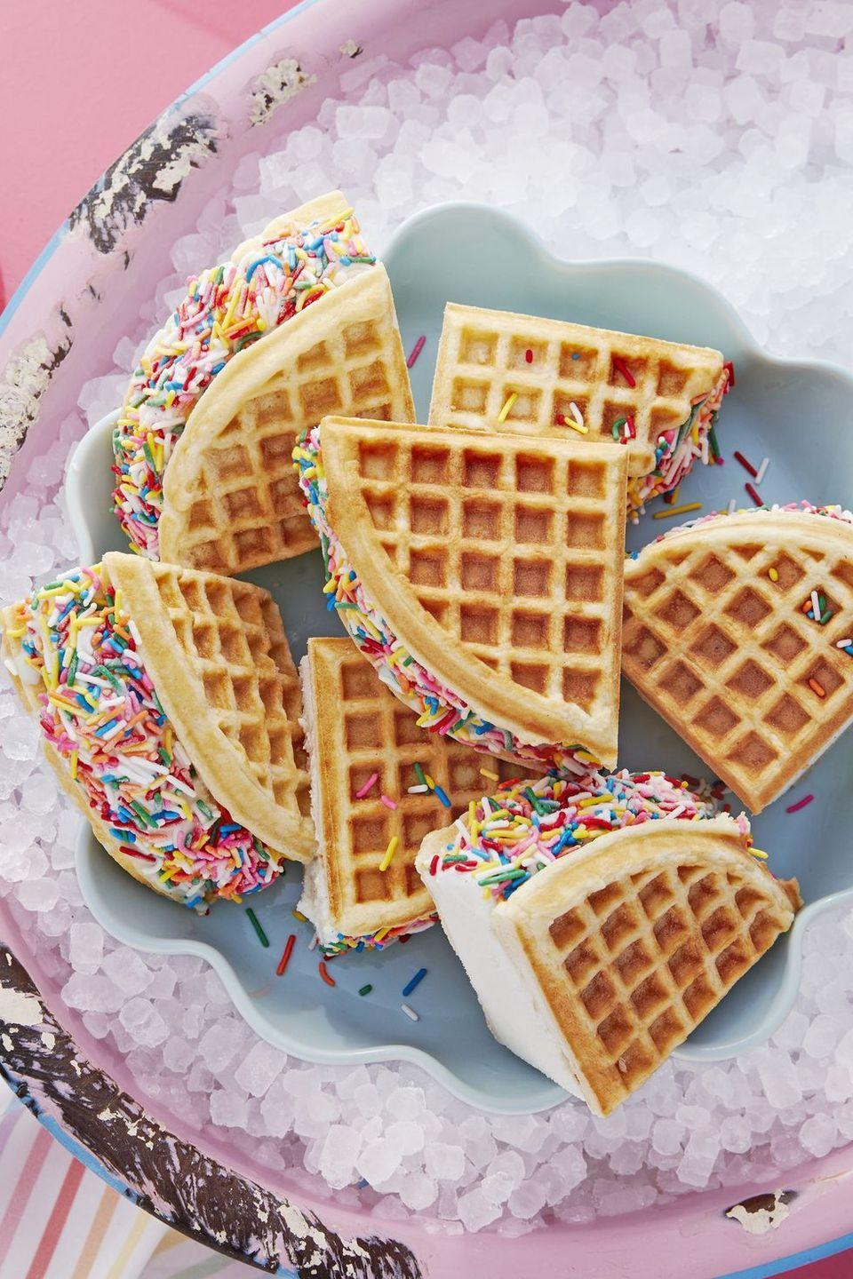 """<p>Sandwich homemade (or store-bought!) waffles with ice cream and roll in colorful sprinkles. </p><p><strong><a href=""""https://www.countryliving.com/food-drinks/a20748103/rainbow-waffle-sandwiches-recipe/"""" rel=""""nofollow noopener"""" target=""""_blank"""" data-ylk=""""slk:Get the recipe"""" class=""""link rapid-noclick-resp"""">Get the recipe</a>.</strong> </p>"""