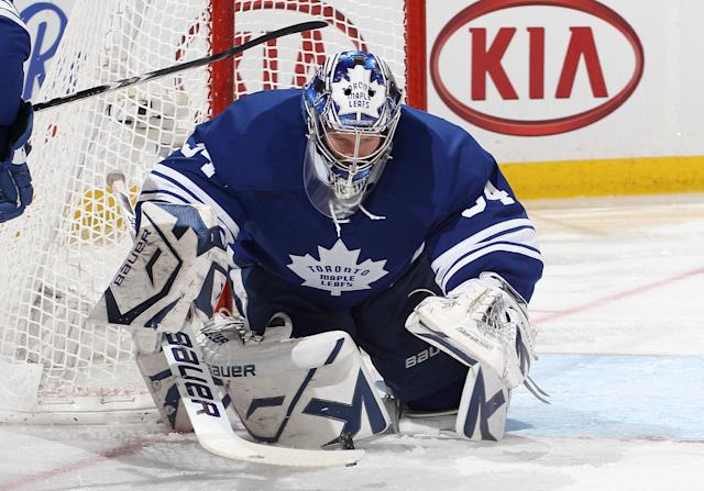 OTTAWA, CANADA - FEBRUARY 4: James Reimer #34 of the Toronto Maple Leafs makes one of his forty-nine saves on the way to a shutout during an NHL game against the Ottawa Senators at Scotiabank Place on February 4, 2012 in Ottawa, Ontario, Canada. (Photo by Jana Chytilova/Freestyle Photography/Getty Images)
