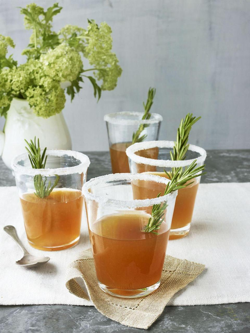 """<p>Honey, cognac, and an infusion of rosemary—this sweet, boozy drink is great for the holidays or any time.</p><p><strong><a href=""""https://www.countryliving.com/food-drinks/recipes/a4153/rosemary-infused-honey-sidecars-recipe-clv0413/"""" rel=""""nofollow noopener"""" target=""""_blank"""" data-ylk=""""slk:Get the recipe"""" class=""""link rapid-noclick-resp"""">Get the recipe</a>.</strong></p>"""