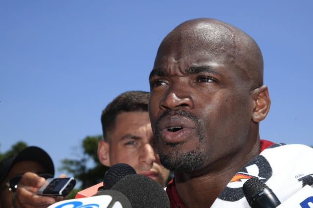FILE - In this June 4, 2019, file photo, Washington Redskins running back Adrian Peterson speaks to reporters following an NFL football minicamp at Redskins Park in Ashburn, Va. In his first public comments since training camp started, Peterson declined to discuss legal issues relating to his finances but was very open about the absence of one of his best friends. Peterson said Tuesday, Aug. 13, 2019, he spoke to Trent Williams several weeks ago about his dispute with the team and hasnt broached the subject since. Peterson says he wouldnt be surprised if Williams returns and wouldnt be surprised if he doesnt. (AP Photo/Manuel Balce Ceneta, File)