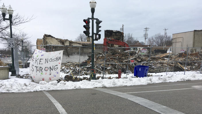 Work continues on a demolished building is shown in Kenosha, Wis., Thursday, Jan. 7. 2021. The chaotic protests that everyone feared would ensue after a prosecutor decided this week not to charge a Wisconsin police officer who shot Jacob Blake, a Black man, in the back haven't materialized as activists bide their time after right-wing extremists stormed the U.S. Capitol. (AP Photo/Mike Householder)