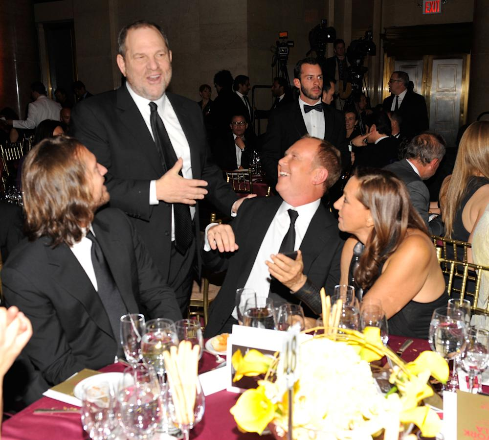 Donna Karan, right, pictured with Harvey Weinstein, second from left, at the amfAR New York Gala in 2011. (Kevin Mazur/Getty Images)