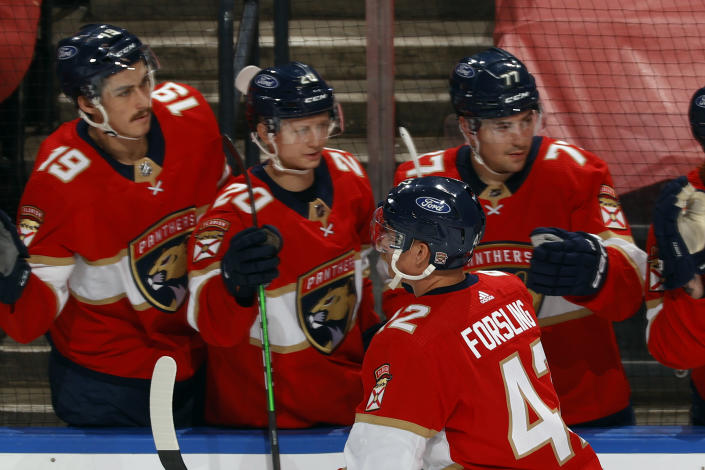 Teammates congratulate Florida Panthers defenseman Gustav Forsling (42) after he scored a goal against the Dallas Stars during the second period of an NHL hockey game, Monday, May 3, 2021, in Sunrise, Fla. (AP Photo/Joel Auerbach)