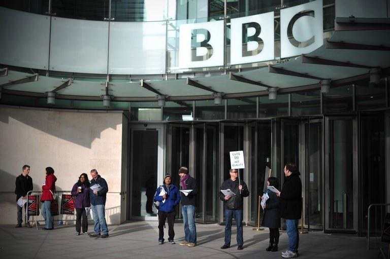 BBC employees hold placards outside Broadcasting House in central London on February 18, 2013