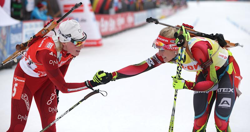 Winner Gabriela Soukalova of Czech Republic, right, congratulates second placed Tora Berger of Norway after the women's Pursuit 10 km competition at the Biathlon World Cup in Ruhpolding, Germany, Sunday, Jan, 12, 2014. (AP Photo/Matthias Schrader)