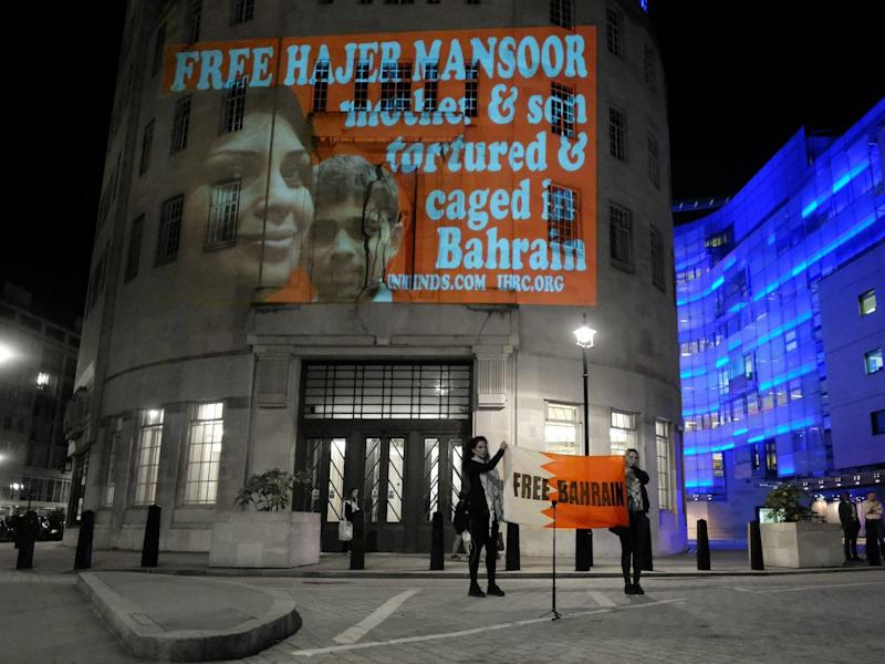 Projection of Hajar Mansoor with her son Sayed Nazar. The family is being targeted by Bahrain authorities in retribution for the human rights work of Sayed Ahmed Alwadaei: Alisdare Hickson