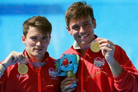 Diving - Gold Coast 2018 Commonwealth Games - Men's Synchronised 10m Platform Final - Optus Aquatic Centre - Gold Coast, Australia - April 13, 2018. Tom Daley and Dan Goodfellow of England hold up their gold medals. REUTERS/Athit Perawongmetha