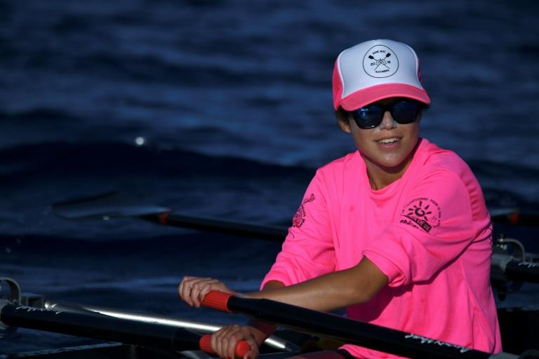 Alexandra Caldas, a 23-year-old woman suffering from cystic fibrosis competes in a nautical marathon, on September 14, 2019 off Bora-Bora in French Polynesia