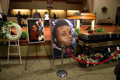 Photos surround Michael Brown's casket before the start of his funeral at Friendly Temple Missionary Baptist Church on Aug. 25. (AFP/Richard Perry)