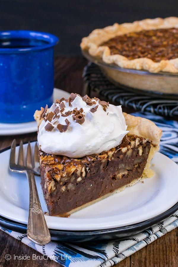 "<p>Can't decide whether to bake a chocolate pie or a pecan pie? With this delectable mashup, you can have both!</p><p><strong>Get the recipe at <a href=""https://insidebrucrewlife.com/chocolate-fudge-pecan-pie/"" rel=""nofollow noopener"" target=""_blank"" data-ylk=""slk:Inside BruCrew Life"" class=""link rapid-noclick-resp"">Inside BruCrew Life</a>.</strong> </p><p><a class=""link rapid-noclick-resp"" href=""https://www.amazon.com/Camp-Chef-True-Seasoned-CIPIE10/dp/B000OXAQ6G?tag=syn-yahoo-20&ascsubtag=%5Bartid%7C10050.g.957%5Bsrc%7Cyahoo-us"" rel=""nofollow noopener"" target=""_blank"" data-ylk=""slk:SHOP PIE PANS"">SHOP PIE PANS</a> </p>"