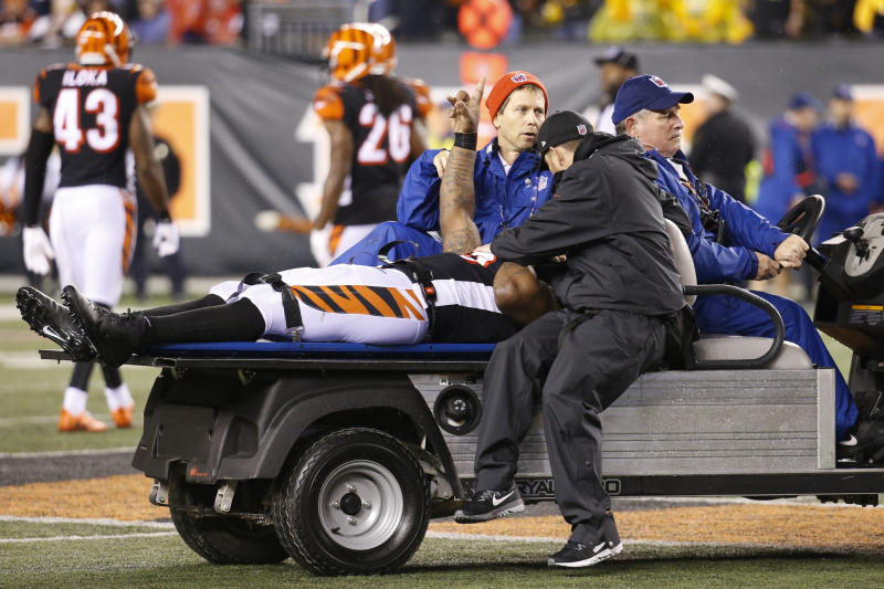 Cincinnati Bengals outside linebacker Vontaze Burfict gestures as he is carted off the field on Monday night. (AP)