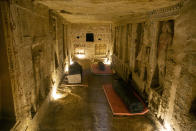 A sarcophagus that is around 2500 years old at the Saqqara archaeological site is shwon, 30 kilometers (19 miles) south of Cairo, Egypt, Saturday, Oct. 3, 2020. Egypt says archaeologists have unearthed about 60 ancient coffins in a vast necropolis south of Cairo. The Egyptian Tourism and Antiquities Minister says at least 59 sealed sarcophagi with mummies inside were found that had been buried in three wells more than 2,600 years ago. (AP Photo/Mahmoud Khaled)