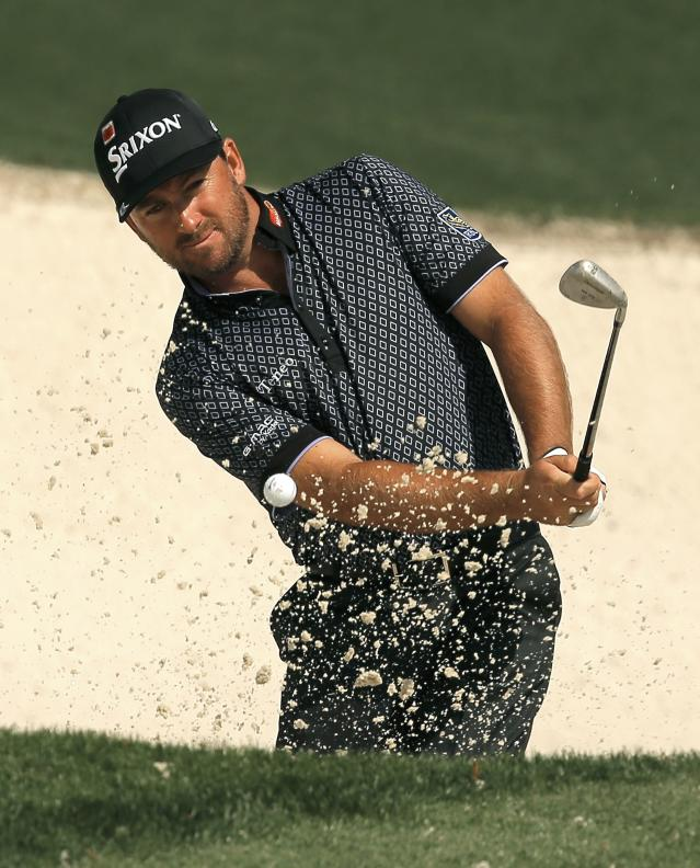 Graeme McDowell of Northern Ireland hits from a sand trap onto the tenth green during his practice round ahead of the 2015 Masters at the Augusta National Golf Course in Augusta