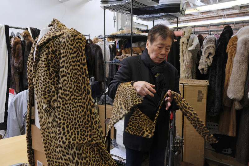 FILE - In this Friday, March 16, 2018, file photo Benjamin Lin looks over a 60-year-old cheetah jacket he is restoring at the B.B. Hawk showroom in San Francisco.  California will be the first state to ban the sale and manufacture of new fur products and the third to bar most animals from circus performances under a pair of bills signed Saturday, Oct. 12, 2019 by Gov. Gavin Newsom.  (AP Photo/Eric Risberg, File)