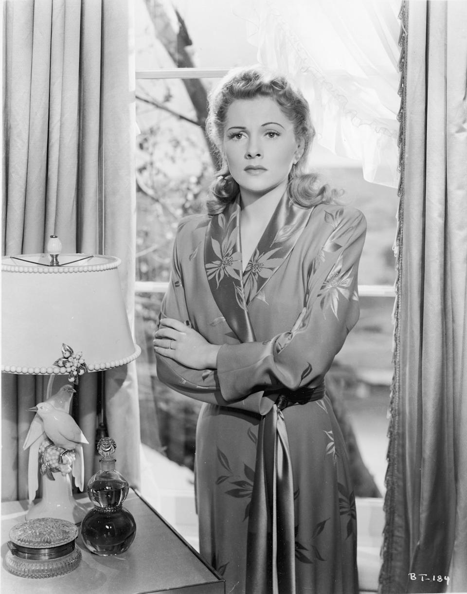 """Fontaine wears a robe with a floral pattern in Alfred Hitchcock's """"Suspicion,"""" 1941."""