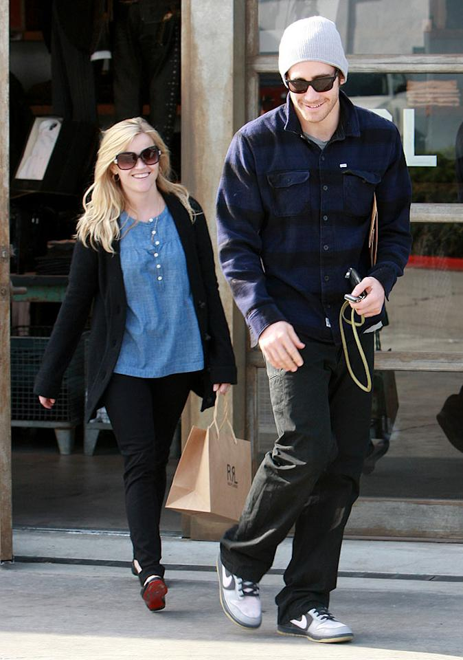 """Lovebirds Reese Witherspoon and Jake Gyllenhaal spend some time -- and some money -- together on Melrose Avenue in West Hollywood, California. Carlos Maidana/<a href=""""http://www.splashnewsonline.com"""" target=""""new"""">Splash News</a> - January 6, 2009"""
