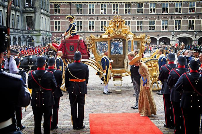 """Netherlands' King Willem-Alexander, center left, and his wife Queen Maxima, center right, arrive for the opening of the new parliamentary year with a speech outlining the government's plan and budget policies for the year ahead, at the 13th century """"Hall of Knights"""" in The Hague, Netherlands, Tuesday, Sept. 17, 2013. (AP Photo/Robin Utrecht, Pool)"""