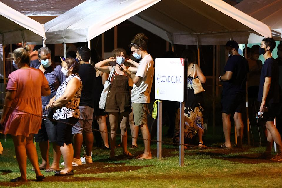 PERTH, AUSTRALIA - JANUARY 31: People are seen queuing at the  Royal Perth Hospital Covid-19 Clinic on January 31, 2021 in Perth, Australia. Premier Mark McGowan has announced a five-day lockdown across the Perth, Peel and South West regions of Western Australia, effective from 6 pm local time on Sunday 21 January. The lockdown measures come following the discovery of a positive COVID-19 case in a worker at a quarantine hotel. From 6 pm, people in the Perth, Peel and South West regions of Western Australia will be subject to stay at home orders, and will only be allowed to leave their homes to shop for essentials, for medical or health needs, exercise within their neighbourhood or to travel to work if they cannot work from home. Face masks will be mandatory outdoors. All restrictions are in place until 6pm on February 5. (Photo by Paul Kane/Getty Images)