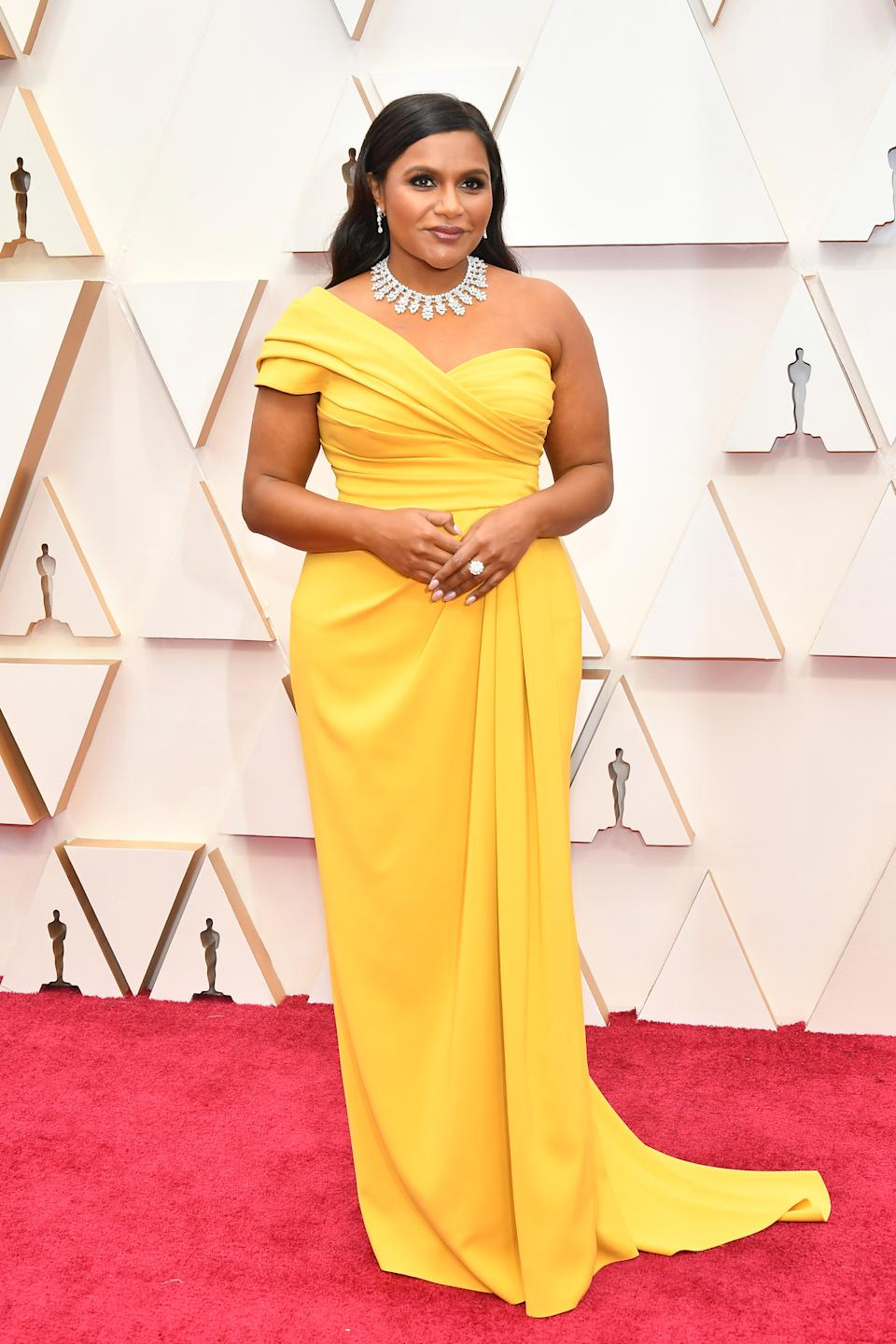 """Kaling brought the glamour in a one-shoulder canary yellow Dolce & Gabbana gown. The """"Late Night"""" writer and actress is set to take the stage as an Oscars presenter."""