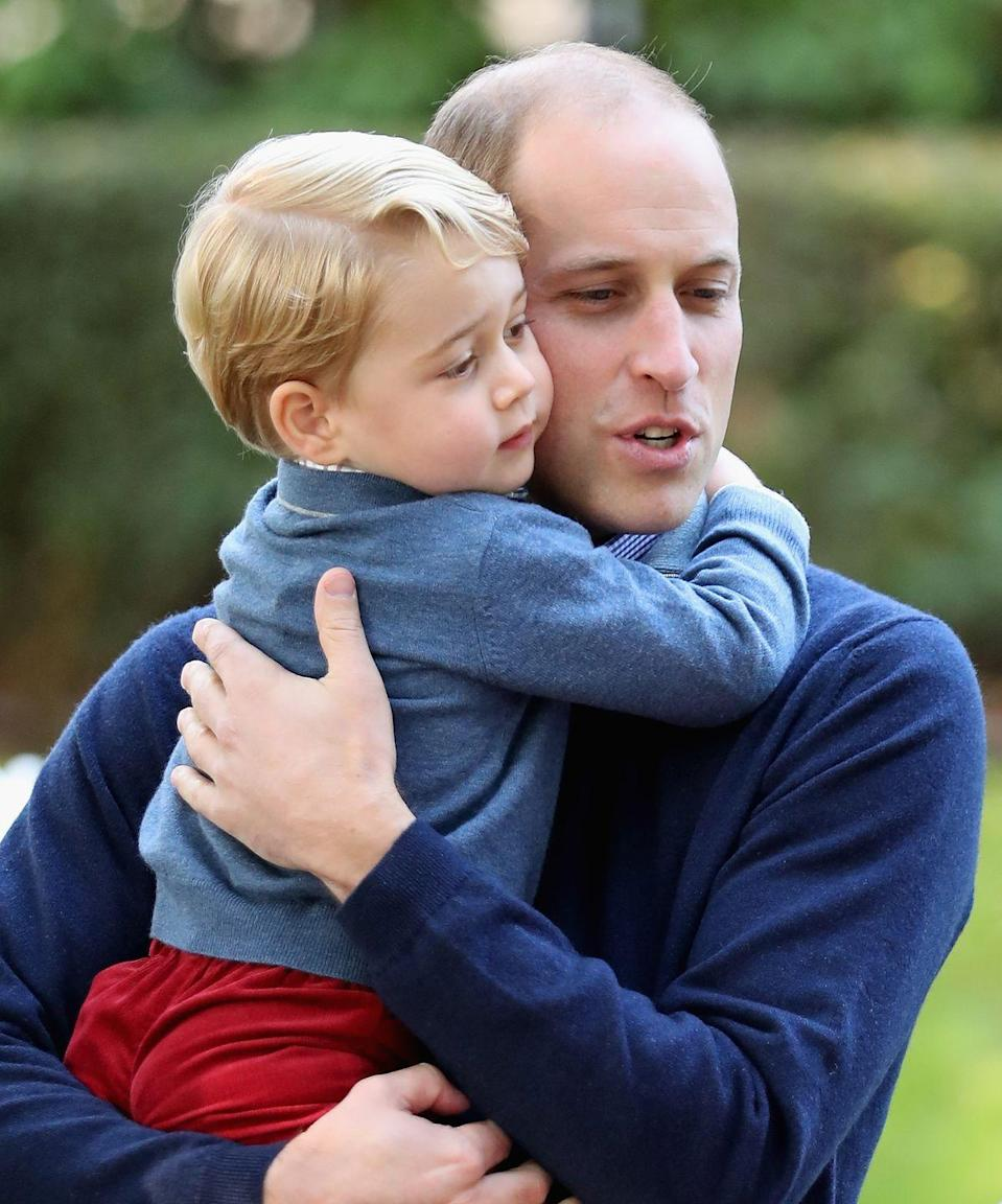 """<p>George and William share a hug at a children's party for military families in Victoria during an official royal tour of Canada in September 2016. In a 2017 interview with <a href=""""http://www.gq-magazine.co.uk/article/prince-william-diana-princess-of-wales"""" rel=""""nofollow noopener"""" target=""""_blank"""" data-ylk=""""slk:GQ"""" class=""""link rapid-noclick-resp""""><em>GQ</em></a>, William stressed the importance of family, home, and his hopes for his children. """"I want to bring up my children in a happy, stable, secure world, and that is so important to both of us as parents. I want George to grow up in a real, living environment, I don't want him growing up behind palace walls; he has to be out there. The media makes it harder, but I will fight for them to have a normal life.""""</p>"""