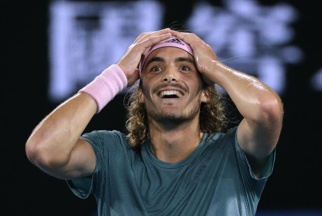 FILE - In this Jan. 20, 2019, file photo, Greece's Stefanos Tsitsipas celebrates after defeating Switzerland's Roger Federer in their fourth round match at the Australian Open tennis championships in Melbourne, Australia. Of particular interest is when a new face will emerge from the crop of 20-somethings who have been rising in the rankings. (AP Photo/Mark Schiefelbein, File)