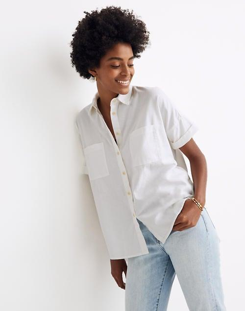 """<h2>Madewell White Cotton Courier Shirt</h2><br><strong>The Best Short-Sleeve White Button-Down</strong><br>Oftentimes, white button-downs are reserved for formal environments. This boxy, short-sleeved version is a refreshing antidote to the fitted look. Plus, as plenty of reviewers mentioned, this top isn't see-through, which means you can wear it with confidence in professional workplaces.<br><br><strong>The Hype:</strong> 4.1 out of 5 stars and 243 reviews on Madewell<br><br><strong>What They're Saying: </strong>""""I have always loved Madewell's courier shirts. They work super well for tiny people, especially those with small frames and short torsos. I particularly like this one because it is so essential to have a nice white shirt. It's loose enough that it doesn't look like a waitress shirt but still is designed for small shoulders so it doesn't look like you are a 5-year-old dressing up.<br>Another important thing about this particular shirt is that it is super thick. No see-through here. I teach so it's important that my professional shirts don't allow my bra to be seen. I love this shirt and I'm pretty sure my students think I live in it.""""<br><br><br><strong>Madewell</strong> White Cotton Courier Shirt, $, available at <a href=""""https://go.skimresources.com/?id=30283X879131&url=https%3A%2F%2Fwww.madewell.com%2Fwhite-cotton-courier-shirt-99104872667.html"""" rel=""""nofollow noopener"""" target=""""_blank"""" data-ylk=""""slk:Madewell"""" class=""""link rapid-noclick-resp"""">Madewell</a>"""