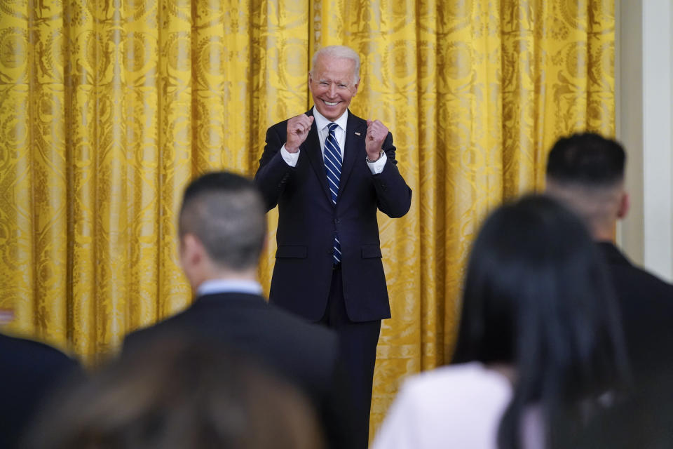 President Joe Biden smiles after people took the Oath of Allegiance during a naturalization ceremony in the East Room of the White House, Friday, July 2, 2021, in Washington. (AP Photo/Patrick Semansky)