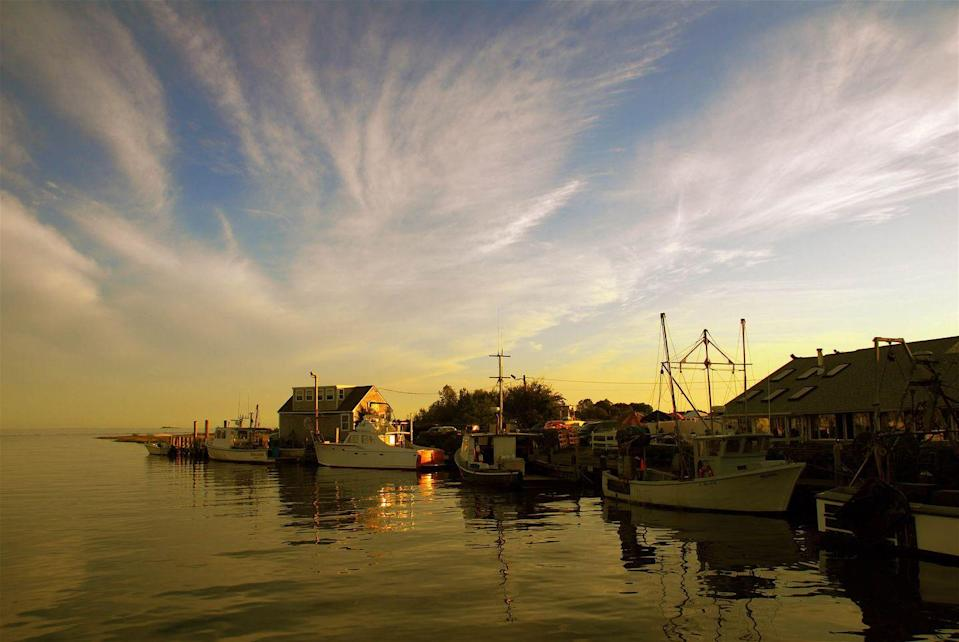 """<p><a href=""""https://www.tripadvisor.com/Tourism-g33798-Guilford_Connecticut-Vacations.html"""" rel=""""nofollow noopener"""" target=""""_blank"""" data-ylk=""""slk:This quiet town"""" class=""""link rapid-noclick-resp"""">This quiet town</a> was first settled in 1639 and is considered to have the third largest collection of historic homes in New England. But even if you're not into history, the shops on the green, local seafood and the peaceful marina are more than worth the trip.</p>"""