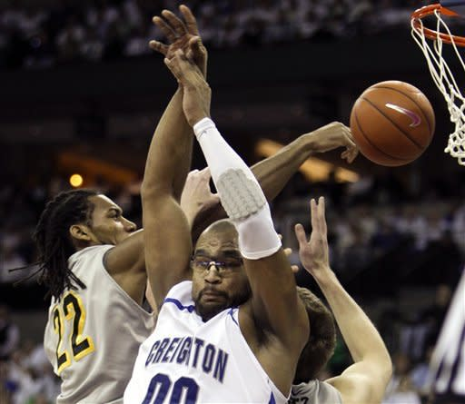 Wichita State's Carl Hall (22) and Garrett Stutz, right, compete for a rebound with Creighton's Gregory Echenique (00) in the first half of their NCAA college basketball game in Omaha, Neb., Saturday, Feb. 11, 2012. (AP Photo/Nati Harnik)