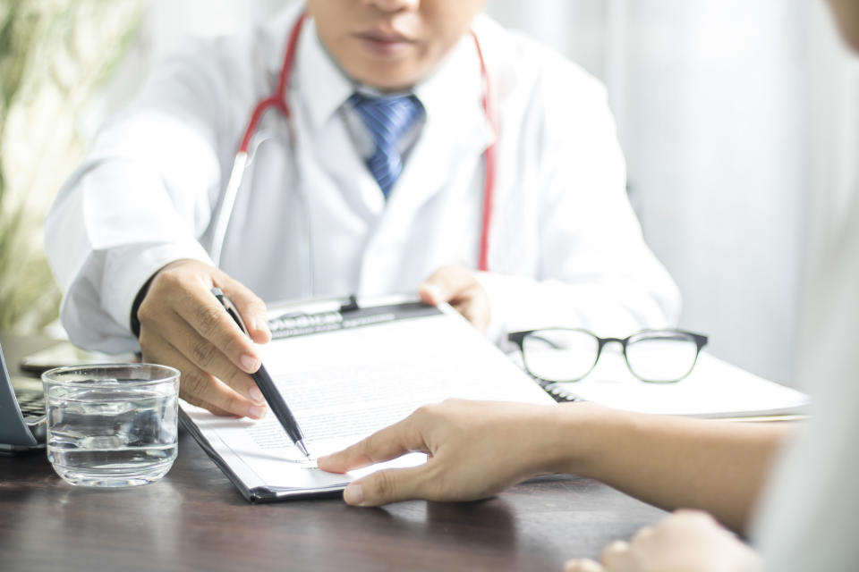 Doctor introduces patient signing on medical records before treat illness in hospitalmm, healthy concept