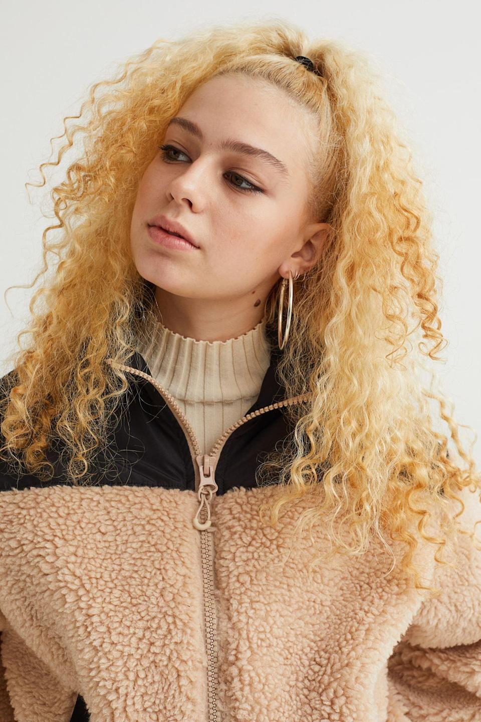 <p>This <span>Faux Shearling Jacket</span> ($32, originally $40) is for the people who stick to neutral colors during the cold seasons. We like the contrast added by the black block.</p>
