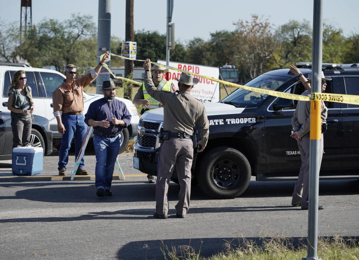 <p>Law enforcement officers man a barricade near the First Baptist Church of Sutherland Springs in response to a shooting, Nov. 5, 2017, in Sutherland Springs, Texas. (Darren Abate/AP) </p>