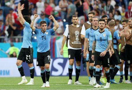 FILE PHOTO: Uruguay's Lucas Torreira and Nahitan Nandez celebrate after the World Cup match against Saudi Arabia - Rostov Arena, Rostov-on-Don, Russia - June 20, 2018. REUTERS/Marko Djurica/File Photo