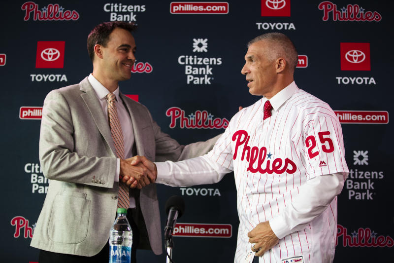 Philadelphia Phillies new manager Joe Girardi, right, shakes hands with Phillies general manager Matt Klentak during a news conference in Philadelphia, Monday, Oct. 28, 2019. The Phillies hired Girardi, the former New York Yankees manager, to replace Gabe Kapler. (AP Photo/Matt Rourke)