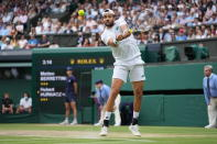 Italy's Matteo Berrettini plays a return to Poland's Hubert Hurkacz during the men's singles semifinals match on day eleven of the Wimbledon Tennis Championships in London, Friday, July 9, 2021. (AP Photo/Alberto Pezzali)