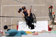 Lai Chi-wai, a paraplegic climber, attends a training session ahead of his attempt to climb the 320-metre tall Nina Tower using his upper body strength, in Hong Kong