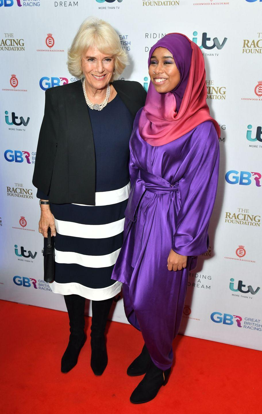 <p>Camilla, Duchess of Cornwall sported a black and white striped skirt while meeting with jockey Khadijah Mellah in London. </p>