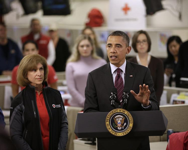 President Barack Obama, accompanied by American Red Cross President and CEO Gail J. McGovern, gestures while speaking during the his visit to the Disaster Operation Center of the Red Cross National Headquarter to discuss superstorm Sandy, Tuesday, Oct. 30, 2012, in Washington. (AP Photo/Pablo Martinez Monsivais)