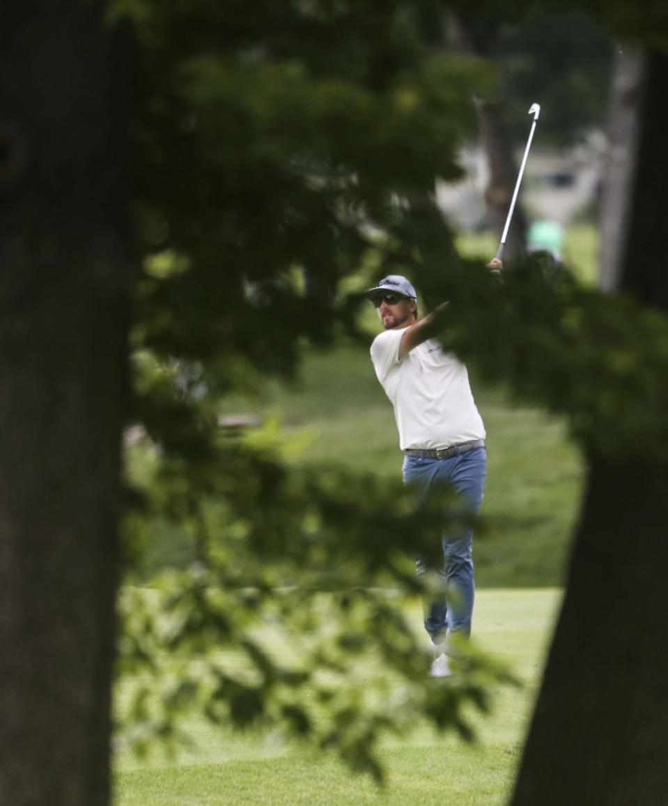 Roger Sloan hits from the fairway on the ninth hole during the second round of the John Deere Classic golf tournament Friday, July 9, 2021, in Silvis, Ill. (Jessica Gallagher/The Dispatch – The Rock Island Argus via AP)