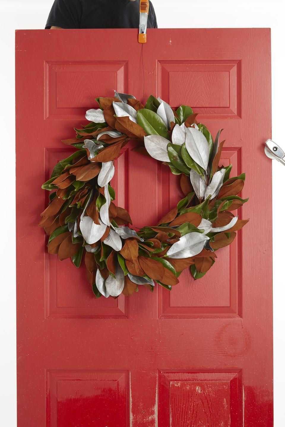 "<p>Scrap together some magnolia branches, a florist's foam wreath, silver acrylic paint, and a paintbrush. Soak the foam wreath in water for five minutes; cut leaves off the magnolia branches and stick them into the wreath, all pointing in the same direction. Paint select leaves silver or gold. </p><p><a class=""link rapid-noclick-resp"" href=""https://www.amazon.com/BD-Crafts-preserved-Magnolia-leaves/dp/B077WY25QW/?tag=syn-yahoo-20&ascsubtag=%5Bartid%7C10055.g.2361%5Bsrc%7Cyahoo-us"" rel=""nofollow noopener"" target=""_blank"" data-ylk=""slk:SHOP FAUX MAGNOLIA LEAVES"">SHOP FAUX MAGNOLIA LEAVES</a></p>"