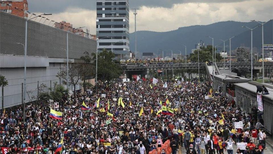 """Demonstrators take part in a protest against the tax reform of President Ivan Duque""""s government in Bogota, Colombia April 28, 2021"""