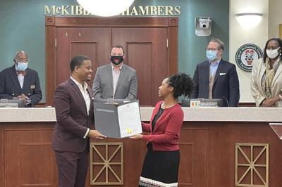 Reco receiving the proclamation declaring January 19th Mr. Reco McDaniel McCambry Day