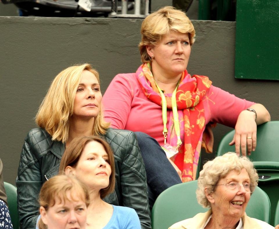Actress Kim Cattrall and TV presenter Clare Balding (top) watch the match between USA's Venus Williams and Japan's Kimiko Date-Krumm on day three of the 2011 Wimbledon Championships at the All England Lawn Tennis and Croquet Club, Wimbledon.