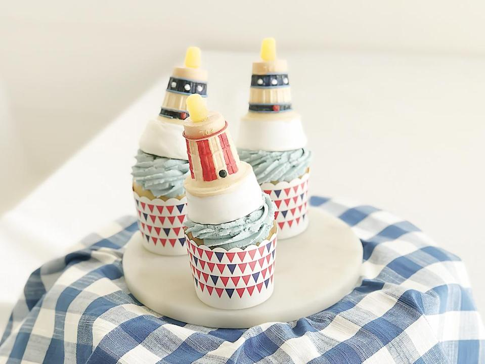 "<p><strong>Recipe: <a href=""https://www.southernliving.com/recipes/dreamsicle-cupcakes-lighthouse-ice-cream-cones"" rel=""nofollow noopener"" target=""_blank"" data-ylk=""slk:Dreamsicle Cupcakes with Lighthouse Ice Cream Cones"" class=""link rapid-noclick-resp"">Dreamsicle Cupcakes with Lighthouse Ice Cream Cones</a></strong></p> <p>Who doesn't love creamy, citrusy Dreamsicle? These patriotic cupcakes are packed with Dreamsicle flavor and topped with royal icing-decorated ice cream cone ""lighthouses."" </p>"