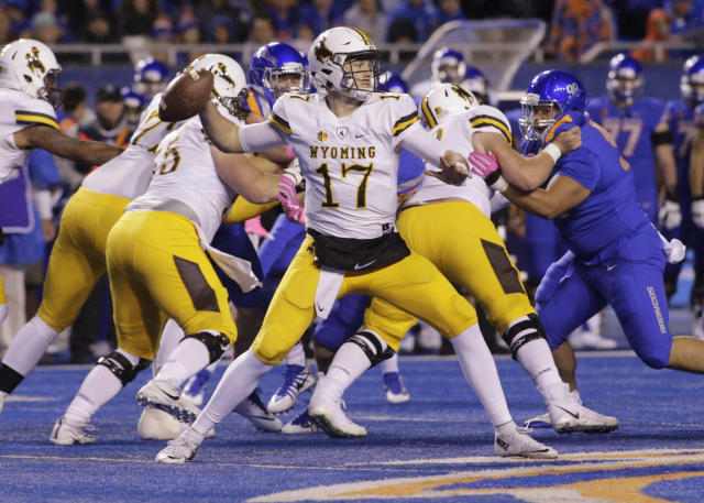 "Wyoming quarterback <a class=""link rapid-noclick-resp"" href=""/nfl/players/28032/"" data-ylk=""slk:Josh Allen"">Josh Allen</a> is among the quarterback who could be drafted first overall. (AP)"